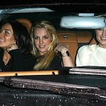 How are they all fitting in the front seat?  There can't be 3 seatbelts!!!